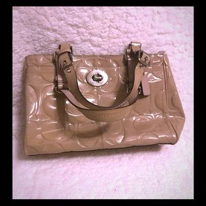 Beautiful Coach embossed patent leather purse.
